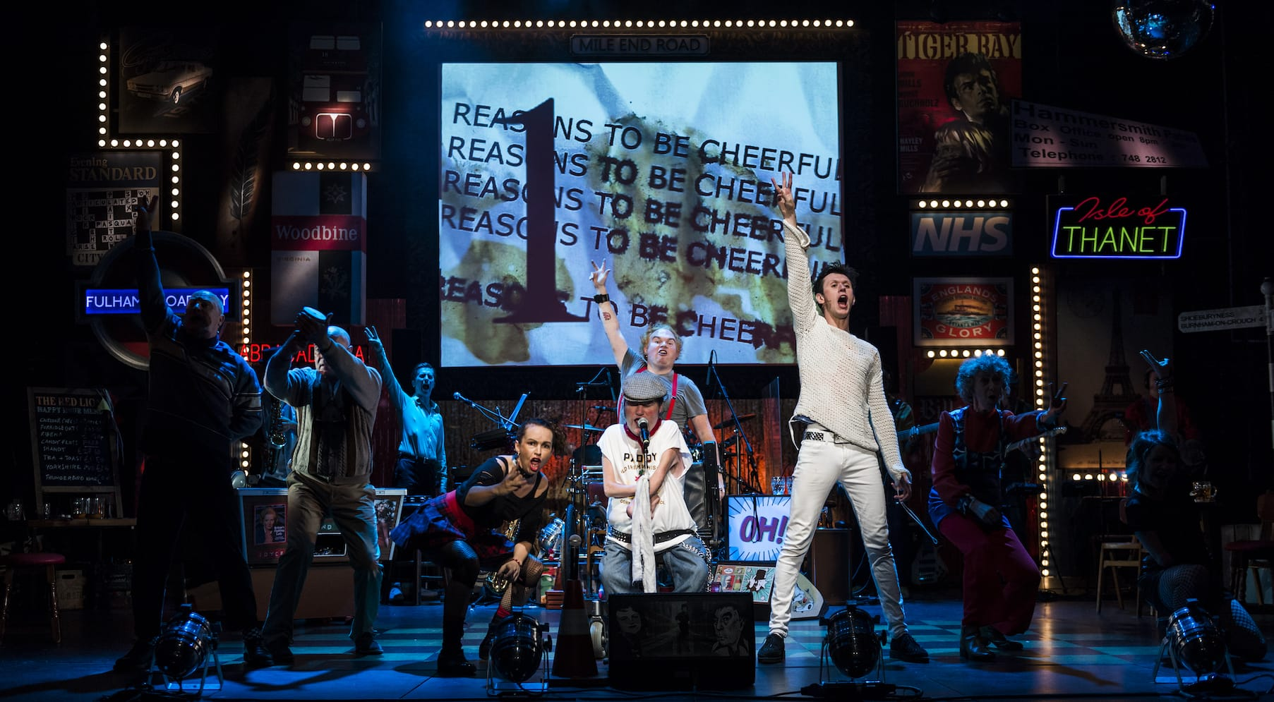 Stage design with projected captions for the production of Reasons to be Cheerful by Graeae Theatre